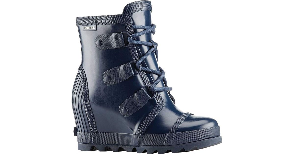 b5943960ed3 Lyst - Sorel Joan Rain Wedge Gloss Boot in Blue