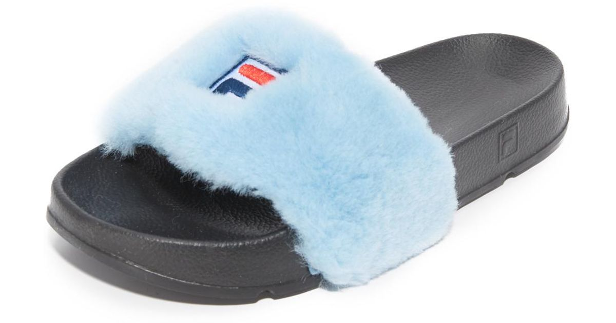 b52fa16c4ddd ... separation shoes b47d8 2ddee Lyst - Baja East X Fila Slides in Blue   buy popular 74c13 d1ffc Latest Style Baja Bast FILA Slip Drifter Womens ...