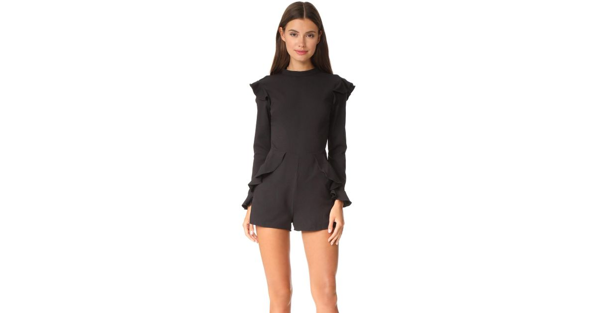 3ad56418c088 Lyst - English Factory Long Sleeve Ruffle Romper in Black