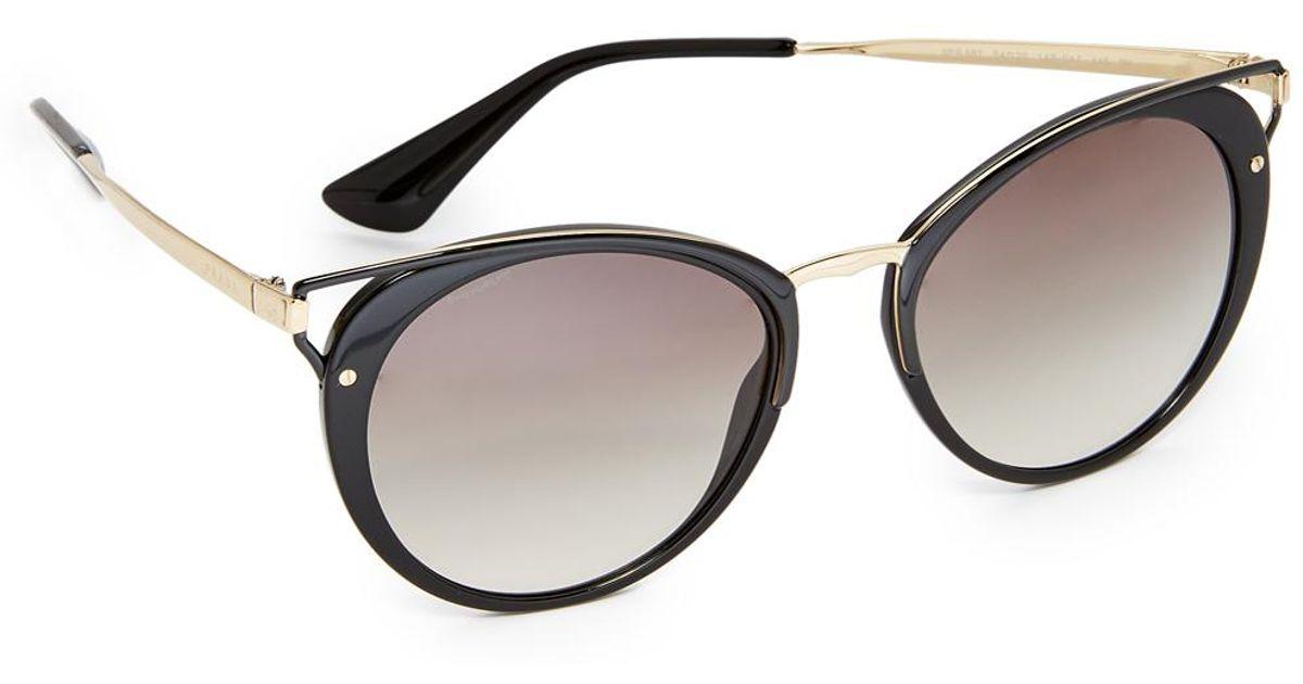 141558e70ef2e Prada Wanderer Sunglasses - Lyst