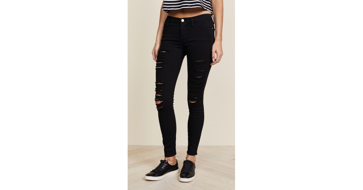 91447cb924a6c Lyst - FRAME Le Color Rip Skinny Jeans in Black