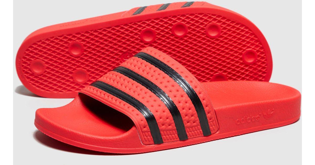 bbf1af9bc469 Lyst - adidas Originals Adilette in Red