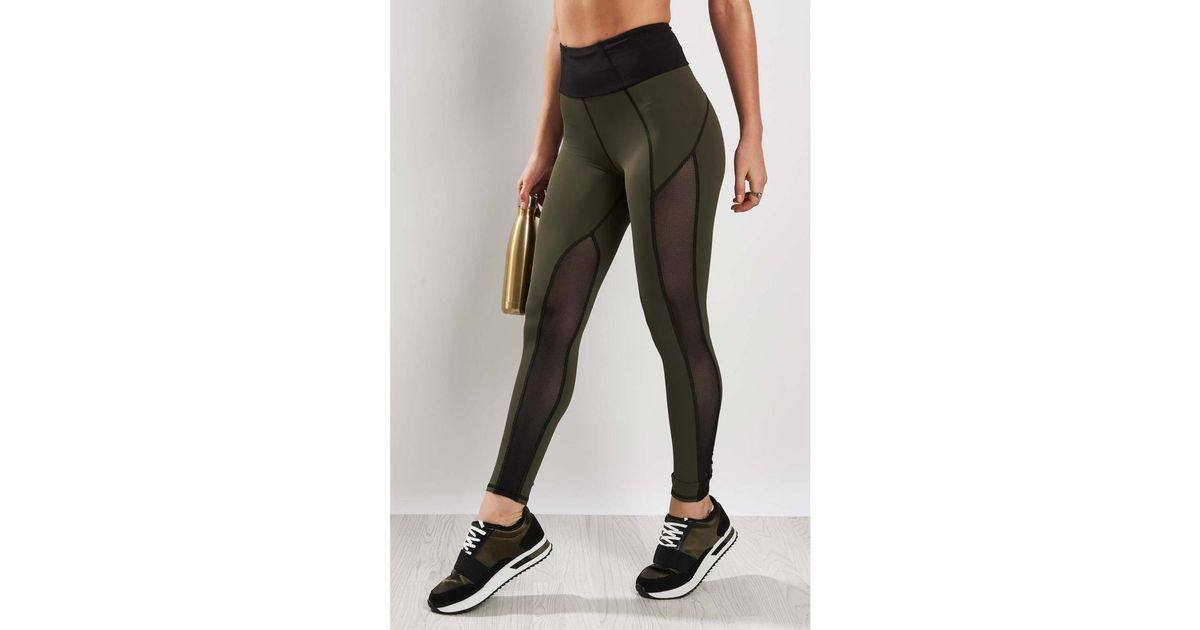 fbc9366bf6288 Michi Summit High Waisted Legging Olive/black - Xs Black Women's Tights In  Black in Black - Lyst