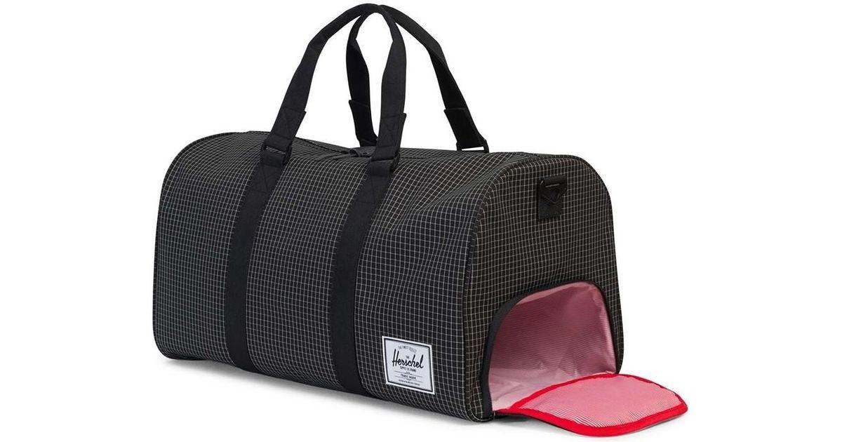 8eb385ff822e5 Herschel Supply Co. Novel Duffle Bag Grid Black Men s Travel Bag In Black  in Black for Men - Lyst