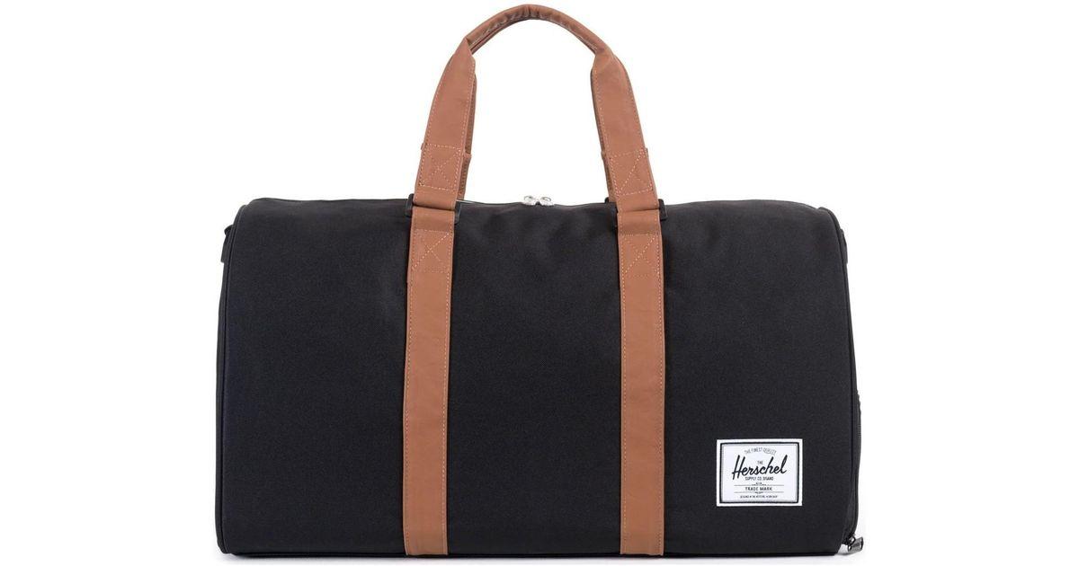 75b5298b98 Herschel Supply Co. Novel Duffle Bag - Black   Tan Synthetic Leather Men s  Travel Bag In Black in Black for Men - Lyst