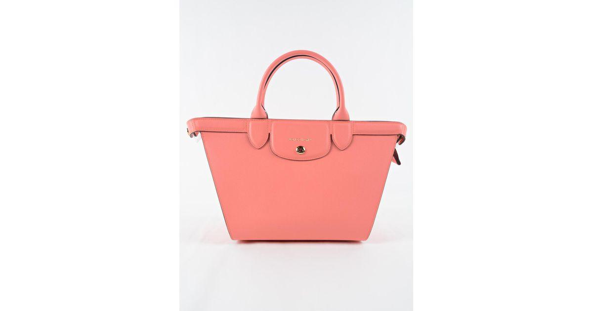 edff5ce96cb ... timeless design d3c5e b86d6 Lyst - Longchamp Le Pliage Heritage Bag M  in Pink ...