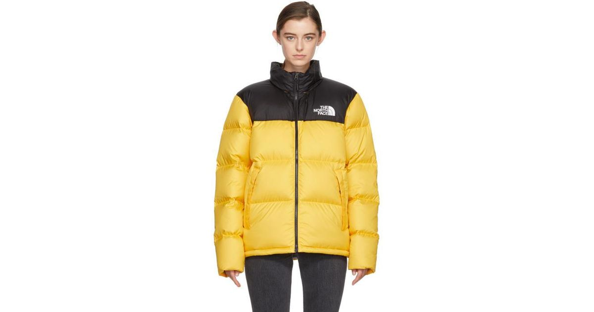 Lyst - The North Face Yellow   Black Down Novelty Nuptse Jacket in Yellow 6d6a8c23b
