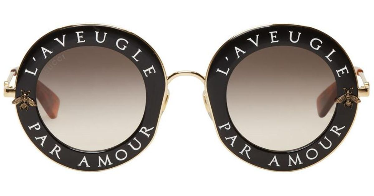 63b08a48824 Lyst - Gucci Black And Gold Laveugle Par Amour Round Sunglasses in Black