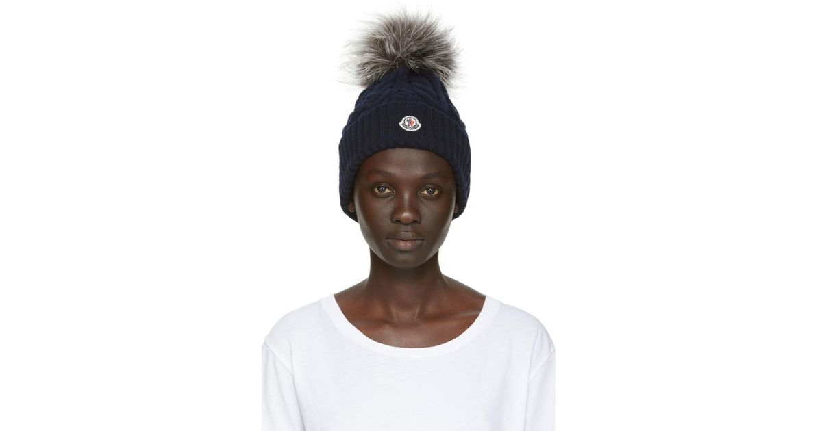 4357dce857f35 Lyst - Moncler Navy Fur Cable Pom Pom Beanie in Blue