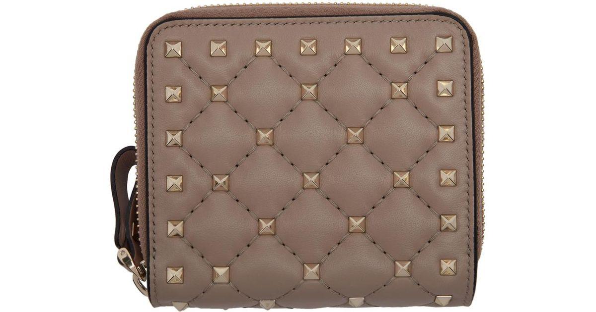 Lyst - Valentino Pink Garavani Rockstud Spike Zip Around French Wallet in  Brown 9f038489c50b9