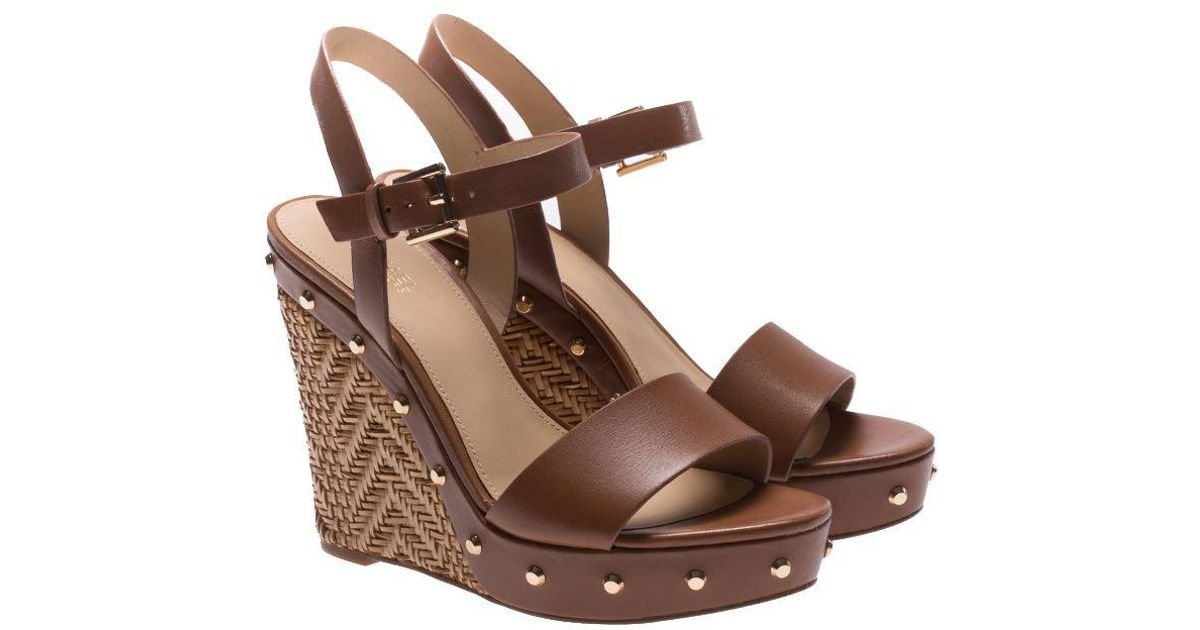8e448ffd68a7 Lyst - Michael Kors Brown Ellen Wedge Sandals in Brown