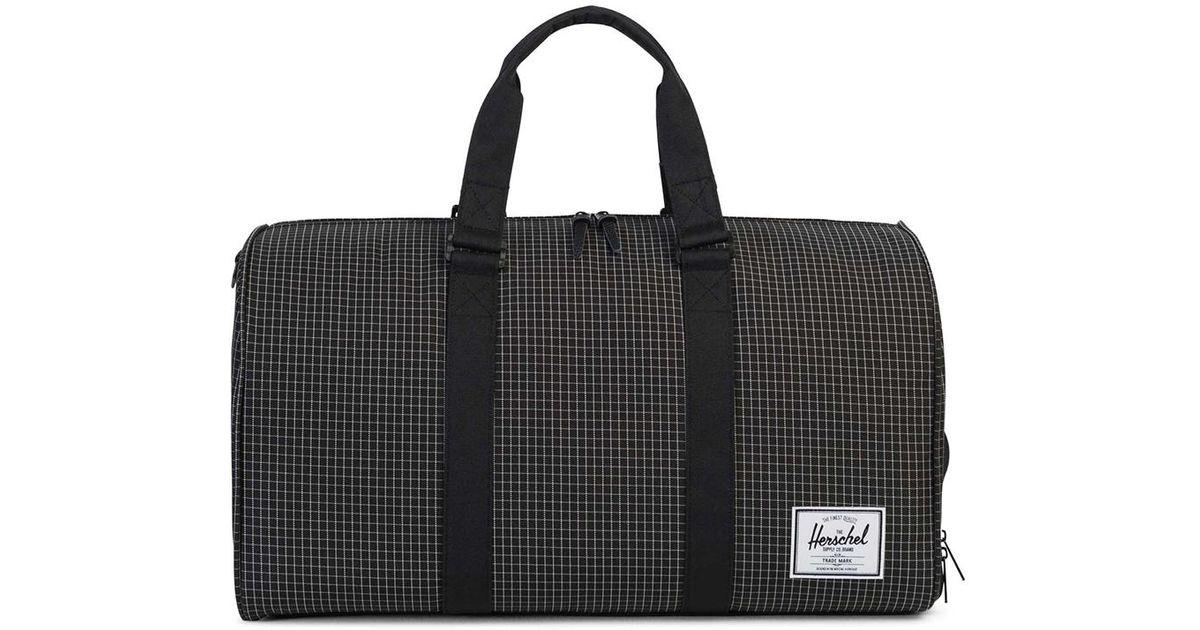 155f7fd42aac Herschel Supply Co. Novel Duffle Bag Grid Black in Black for Men - Lyst