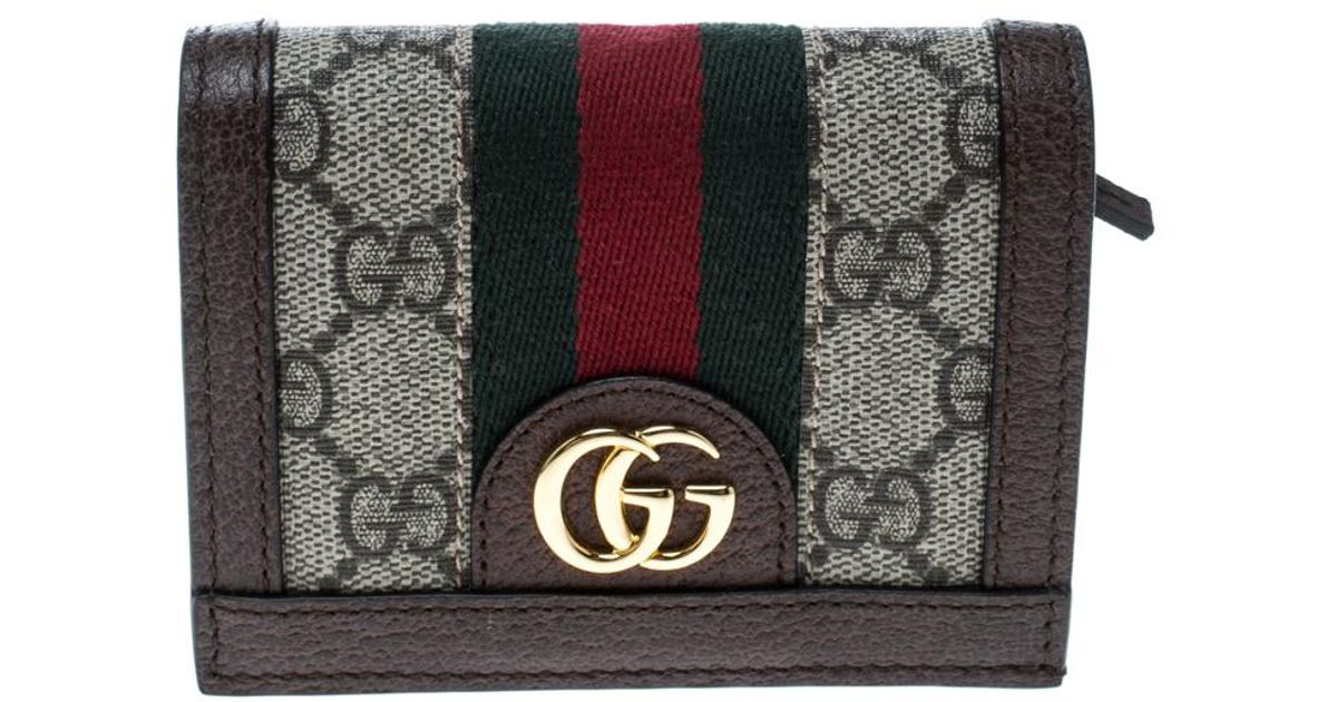 2dd469bb94ce01 Lyst - Gucci /brown GG Supreme Canvas And Leather Ophidia Web Compact Wallet  in Natural