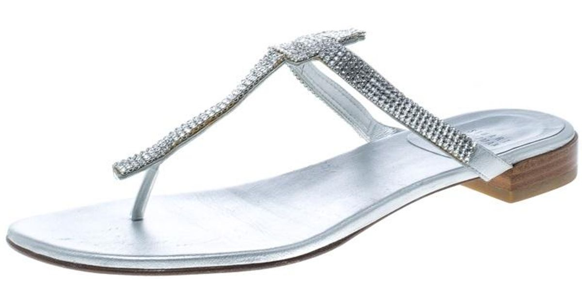 53c790059 Stuart Weitzman Silver Leather Vanity Crystal Encrusted T Strap Flat  Sandals Size 39.5 in Metallic - Lyst