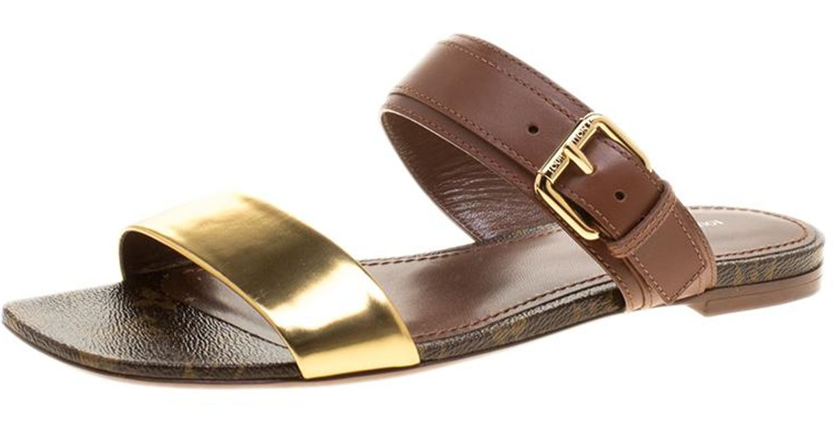 fdee8ea8d030 Lyst - Louis Vuitton Leather And Monogram Canvas Golden Bloom Flat Slides  in Brown