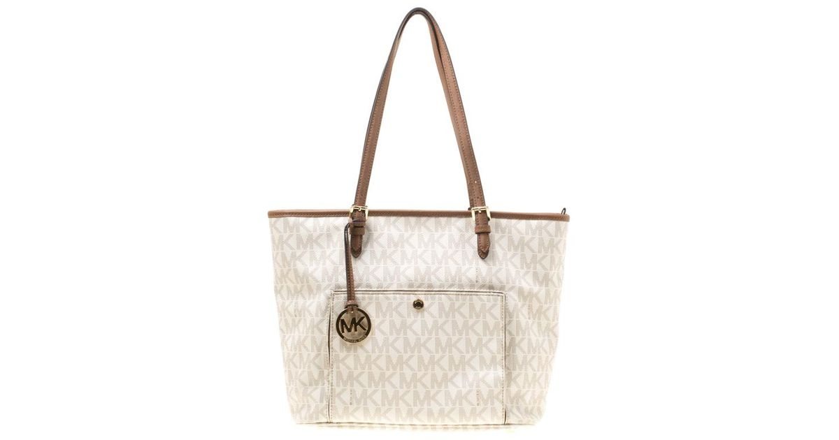 07d5e5a38 MICHAEL Michael Kors Signature Coated Canvas Jet Set Pocket Tote in White -  Lyst