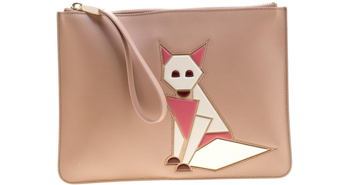28ab4cd8b347c Tod's Leather Fox Wristlet Clutch in Natural - Lyst