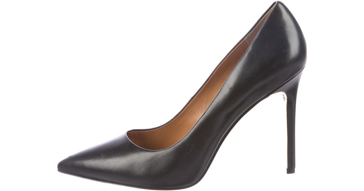 aef675b79af Lyst - Tory Burch Elana Pointed-toe Pumps Black in Metallic