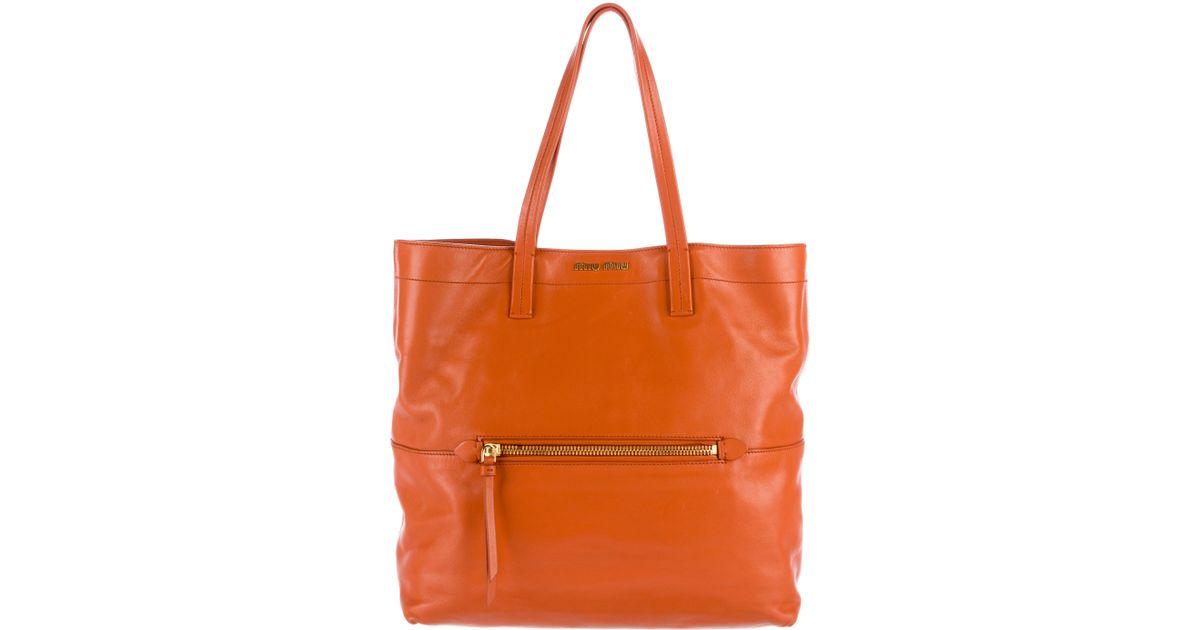 fb88c6711dc7 Lyst - Miu Miu Miu Vitello Soft Tote Orange in Metallic