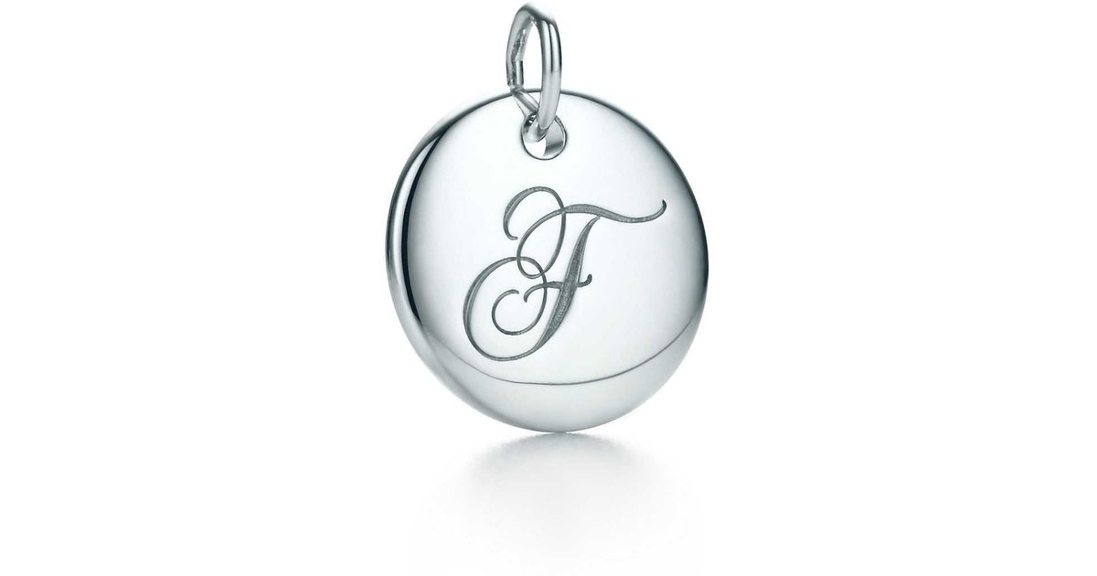 Tiffany Notes alphabet disc charm in 18k gold, small Letters A-Z available - Size A Tiffany & Co.