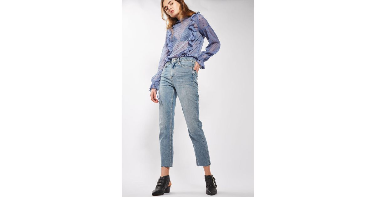 e7e548f1e3b Lyst - TOPSHOP Moto Bleach Raw Hem Straight Leg Jeans in Blue