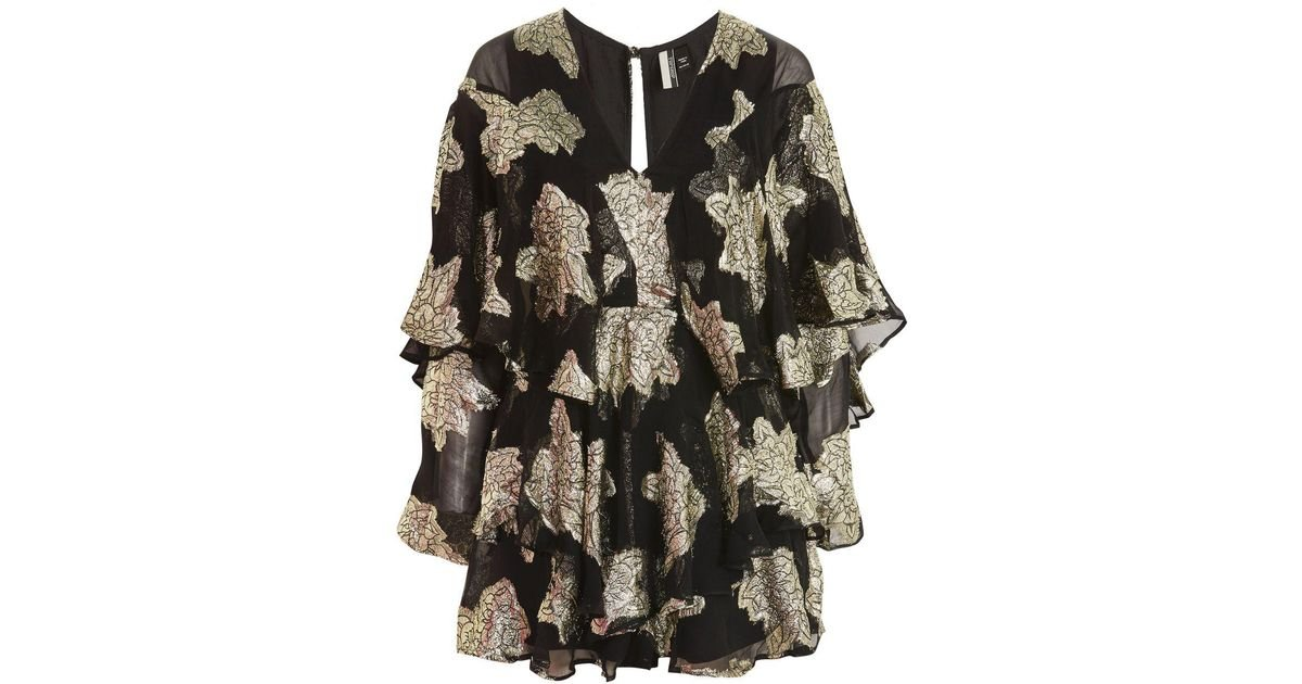 f2dc66049bd Lyst - TOPSHOP Gold Ruffle Sleeve Playsuit in Black