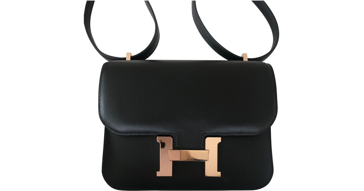 26d59ac39a2e Lyst - Hermès Pre-owned Constance Leather Crossbody Bag in Black