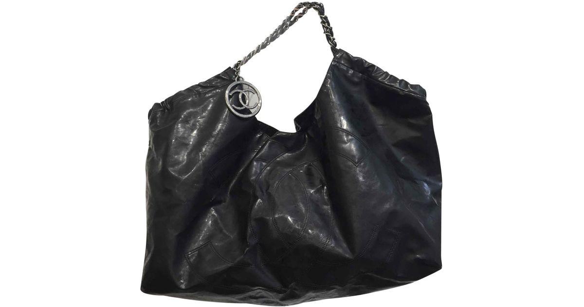 6318f878ad Sac à main Coco Cabas en cuir Chanel en coloris Noir - Lyst