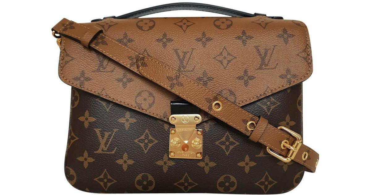 182232c5601e Louis Vuitton Metis Brown Cloth Handbag in Brown - Save 1.5399422521655453%  - Lyst