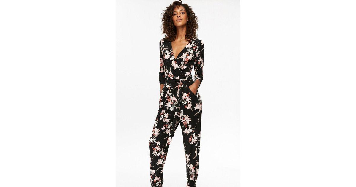 e76d93d9987 Wallis Black Lily Print Jumpsuit in Black - Lyst