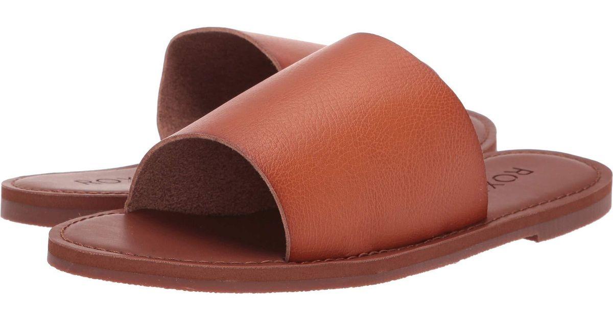28c05c7e4 Lyst - Roxy Kaia Slip Slide Sandal Flat in Brown - Save 3%