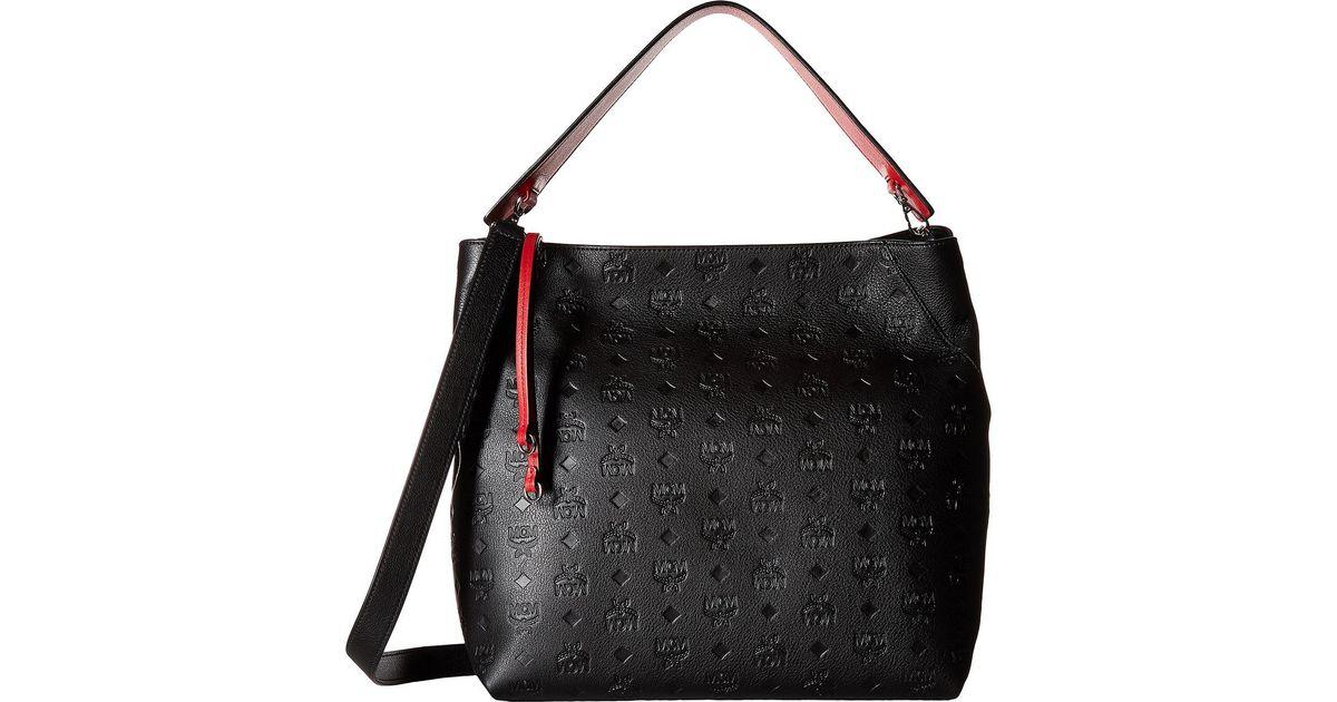 70c5240dca Lyst - MCM Klara Monogrammed Leather Large Hobo in Black