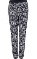 Topshop Mix Diamond Tile Jersey Tapered Trousers - Lyst