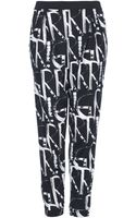 Topshop Grrr Print Jersey Tapered Trousers Monochrome - Lyst