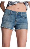 Frame Cut Off Shorts - Lyst
