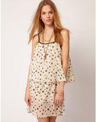 Ganni Ganni Tiered Sun Dress in Splatter Polka Dot Print - Lyst