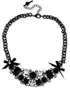 Betsey Johnson Blackplated Crystal And Bow Frontal Necklace - Lyst