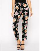 Asos Exclusive Floral Print Slim Leg Pants - Lyst