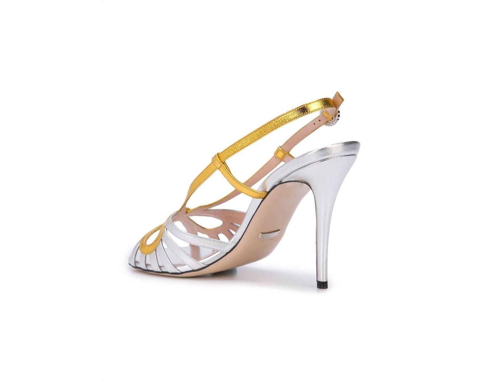 ac2ddc60d Gucci Crossed Bow Sandals in Metallic - Lyst