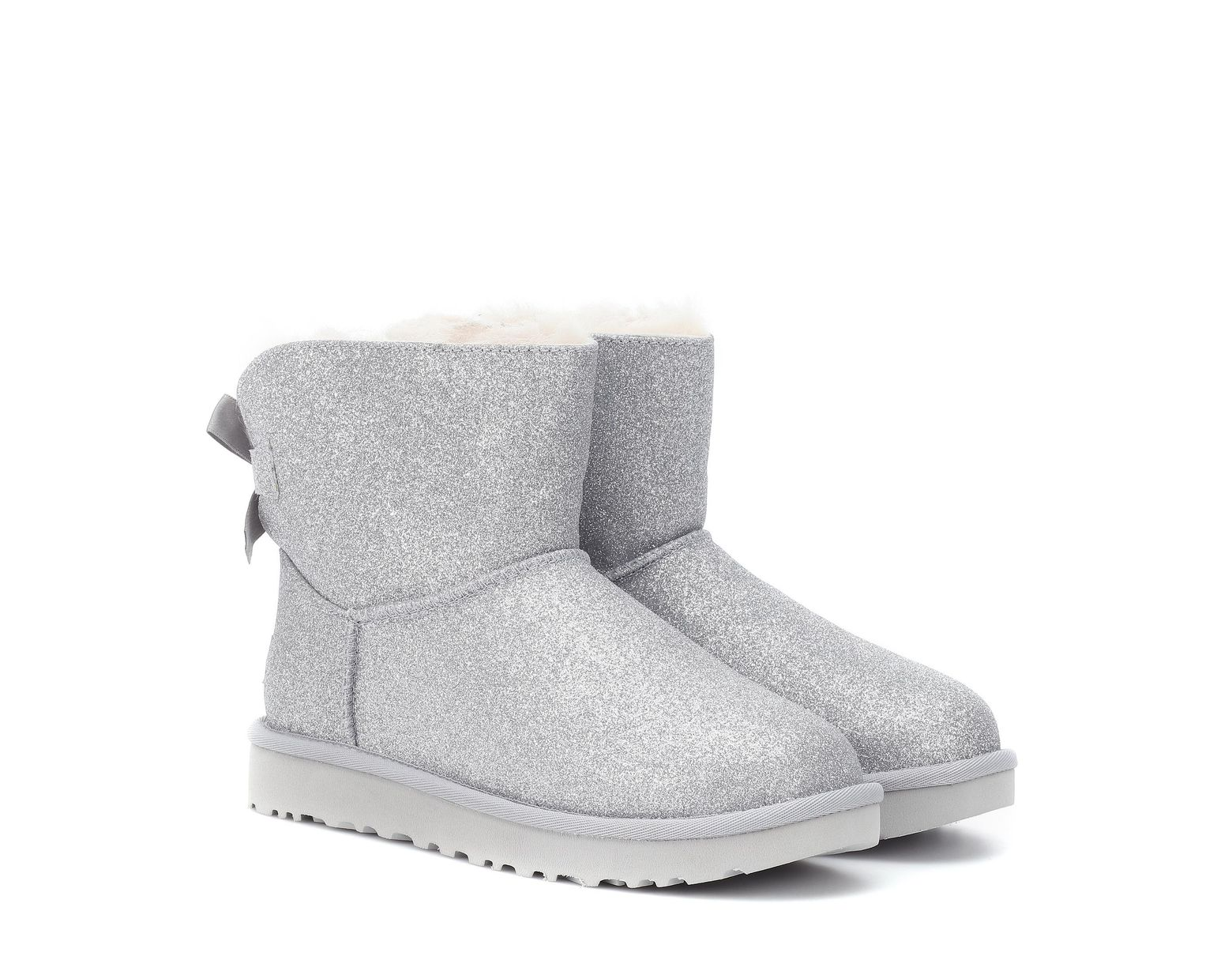 2f5043bfa7 UGG Mini Bailey Bow Glitter Ankle Boots in Metallic - Save 55% - Lyst