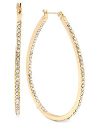 Hint Of Gold - Metallic Large Oval Crystal Hoop Earrings In 14k Gold-plated Brass - Lyst