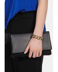 Karen Millen | Metallic Pyramid Stud Turnlock Bracelet | Lyst