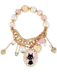 Betsey Johnson | Metallic Gold-tone Cat Charm And Faceted Bead Stretch Bracelet | Lyst