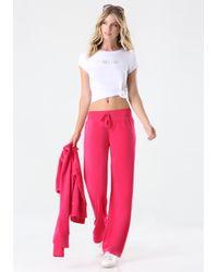 Bebe - Pink Logo Velour Pants - Lyst