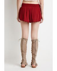 Forever 21 Crochet-trimmed Dolphin Shorts in Red | Lyst