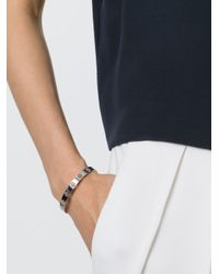 Tory Burch - Metallic Cut Out Logo Bangle - Lyst