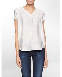 Calvin Klein | White Jeans Subtle Print V-neck Cap Sleeve Top | Lyst