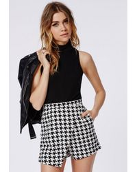 Missguided - High Neck Dogtooth Skort Playsuit Black - Lyst
