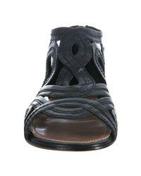 Alaïa | Black Cutout Swirl Leather Flat Sandals | Lyst