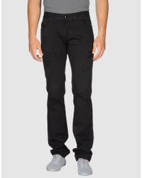 CoSTUME NATIONAL | Black Casual Pants for Men | Lyst